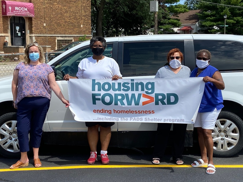 National Express Transit (NEXT) Donates Vehicle to Housing Forward